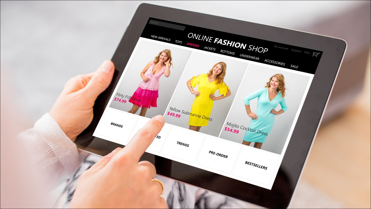 Woman shopping online for new dress