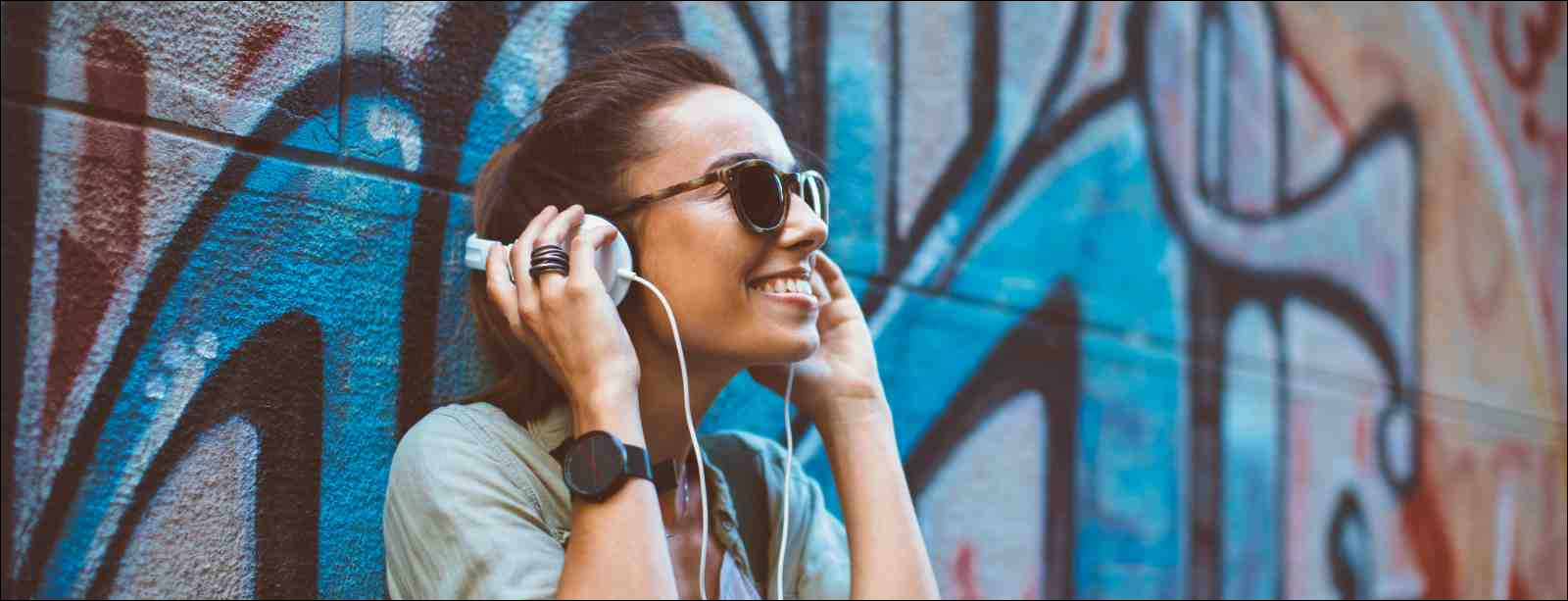 Young woman listening to podcast on headphones
