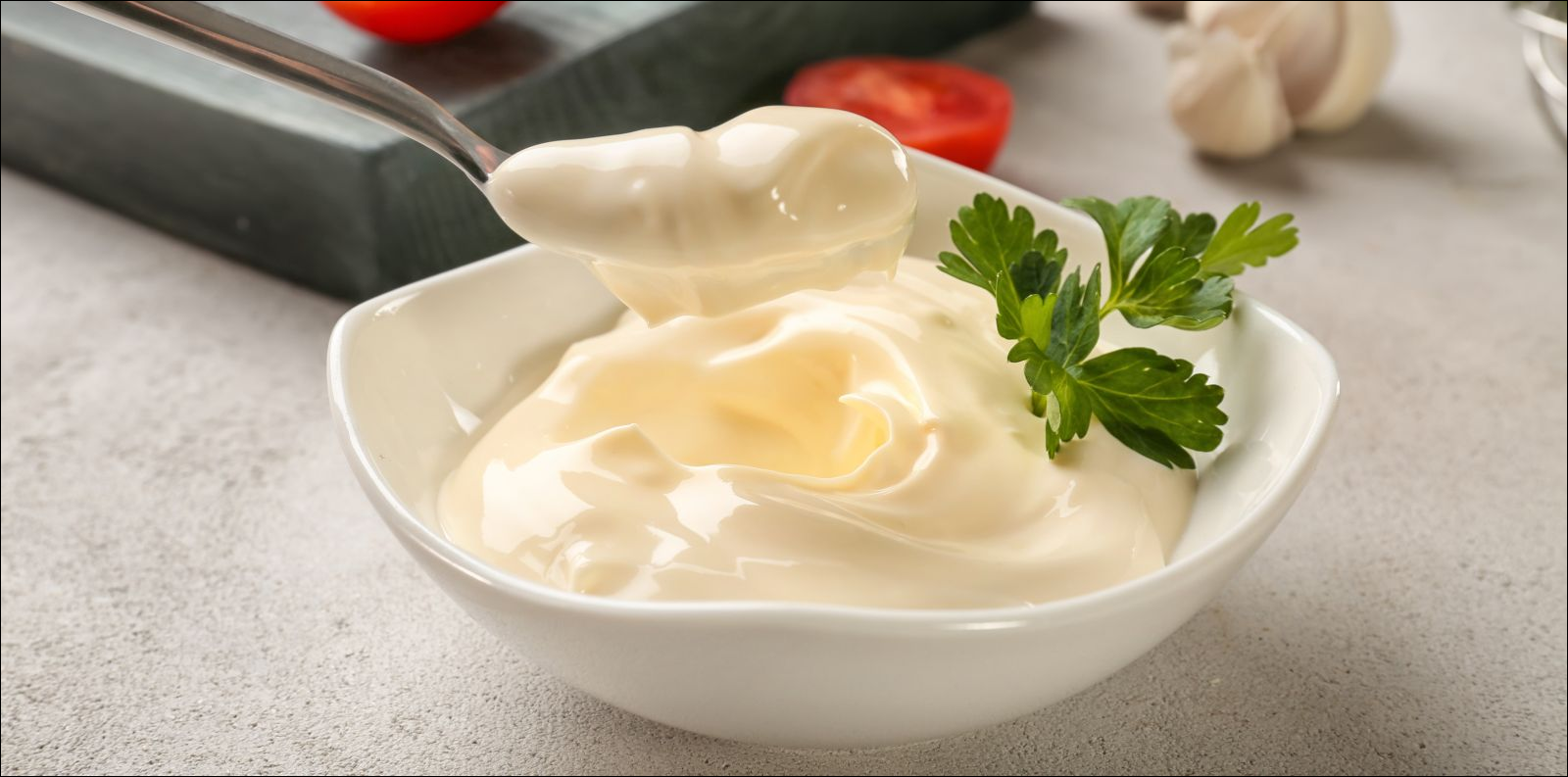 mayonnaise in bowl and spoon on kitchen table