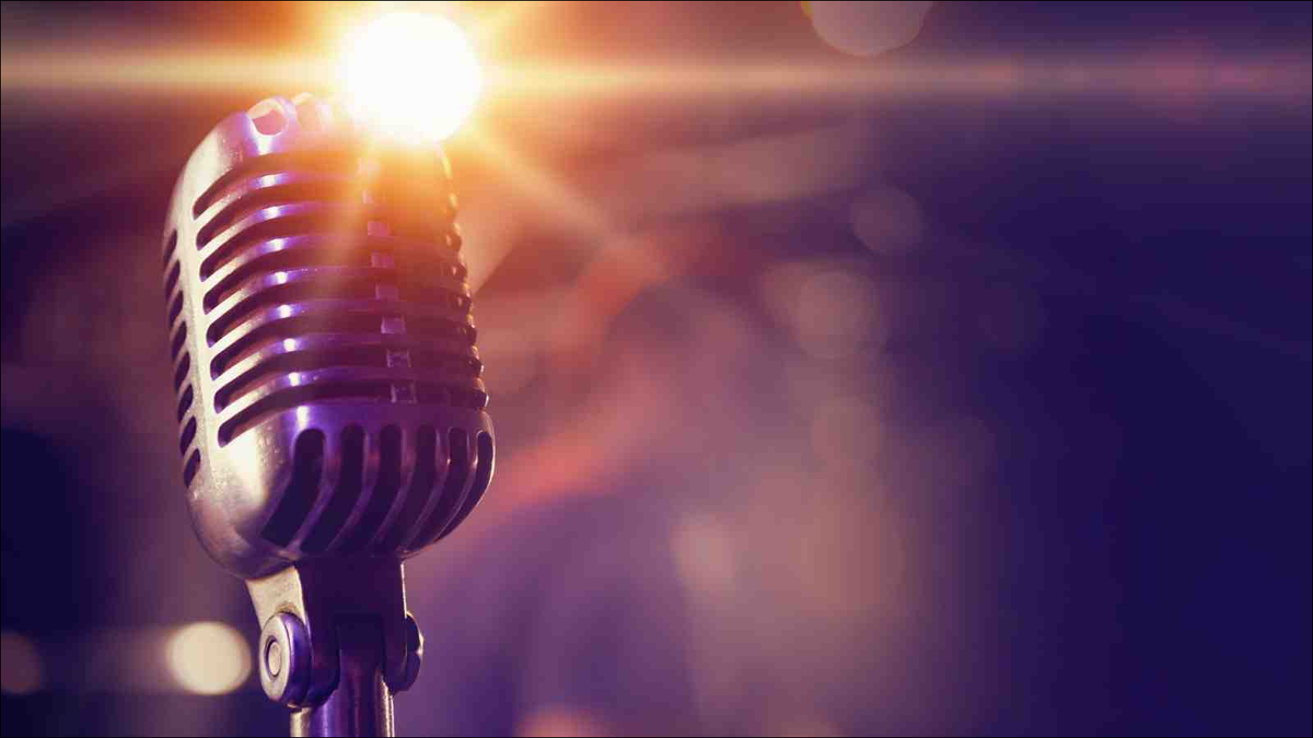 Microphone in front of blurred auditorium