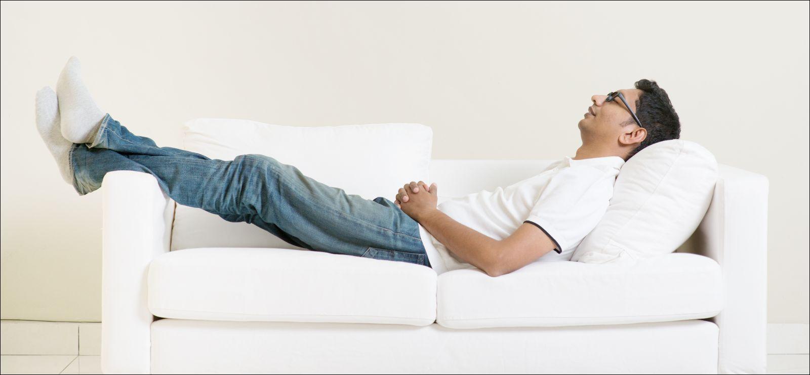 man resting on sofa