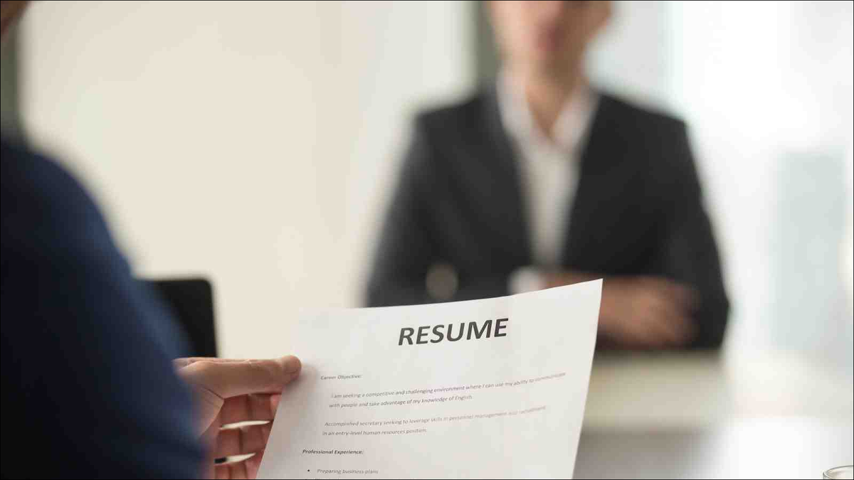 Close up view of job interview in office, focus on resume