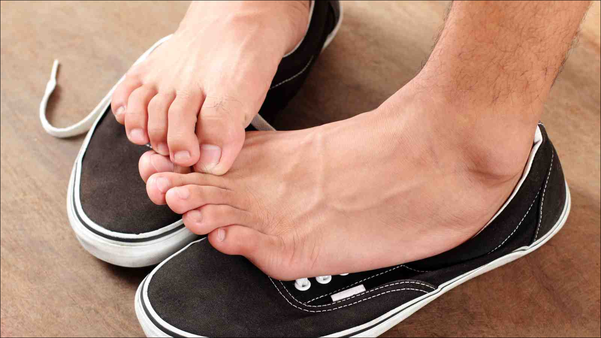 Man scratching his athlete's foot