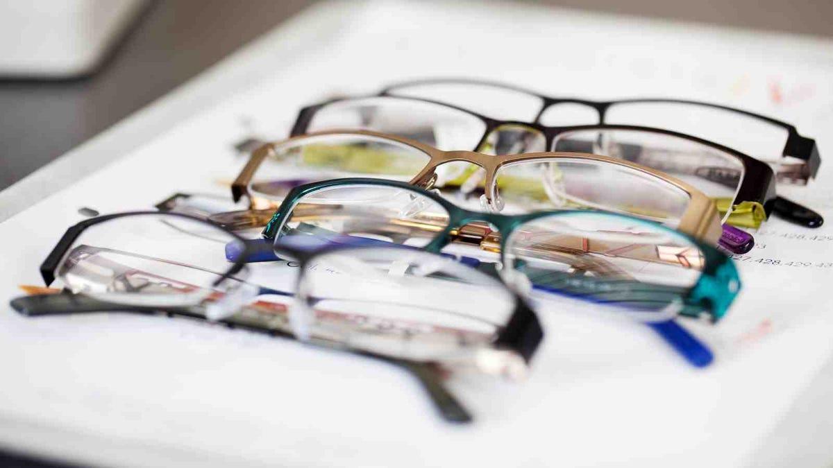 various eyeglasses lying on a tray
