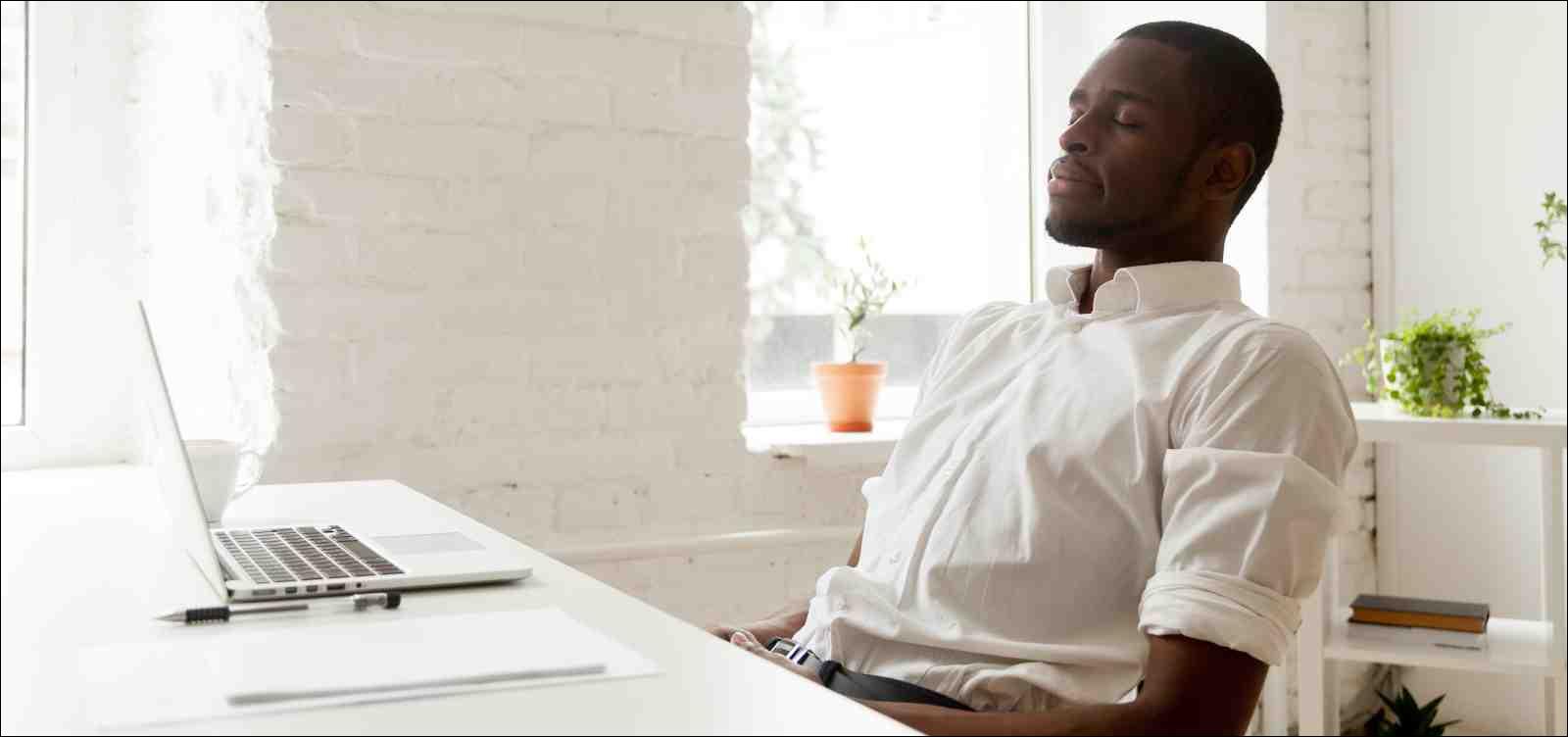 man meditating at desk