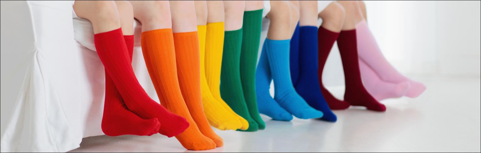 Kids wearing colorful rainbow socks