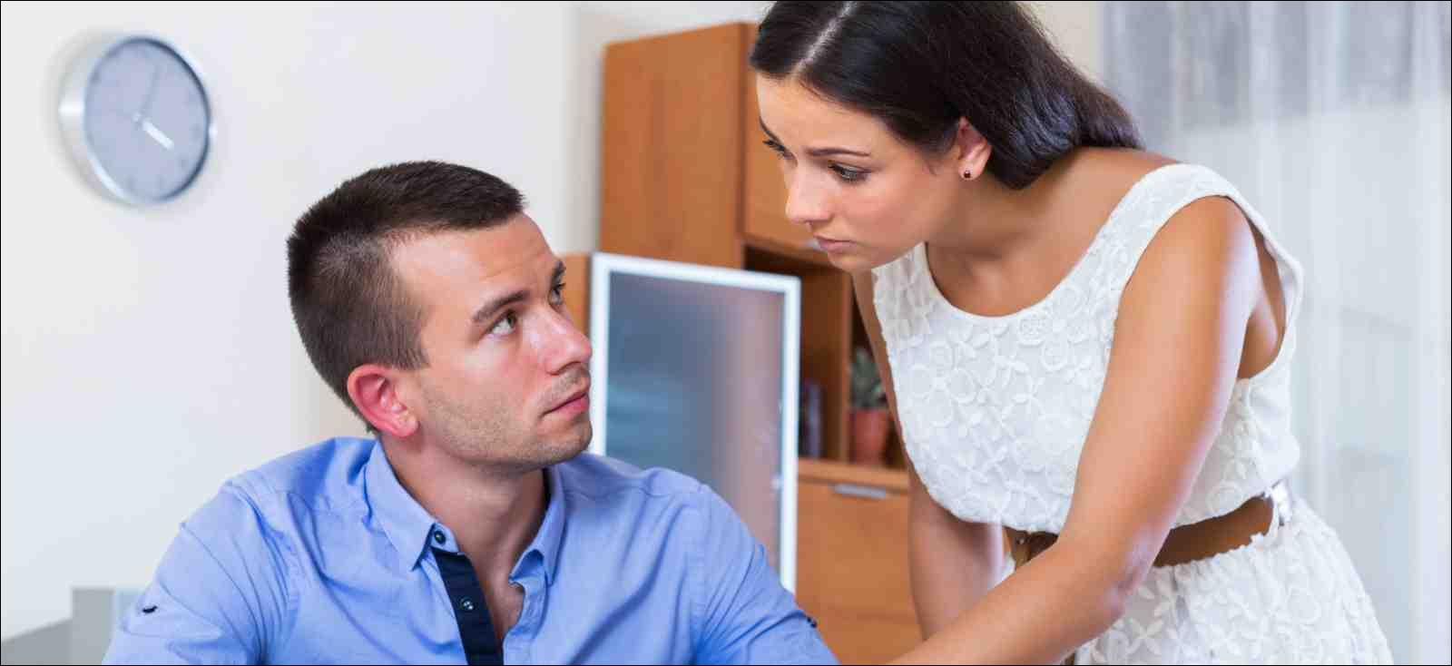 Irritated couple having serious conversation