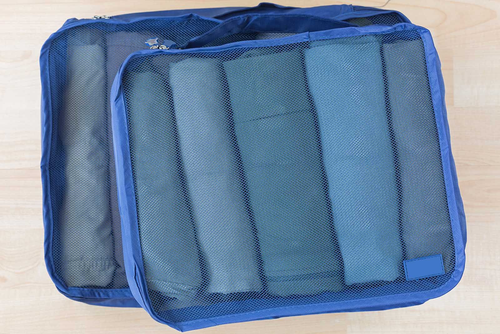 Clothing folded neatly in a packing cube