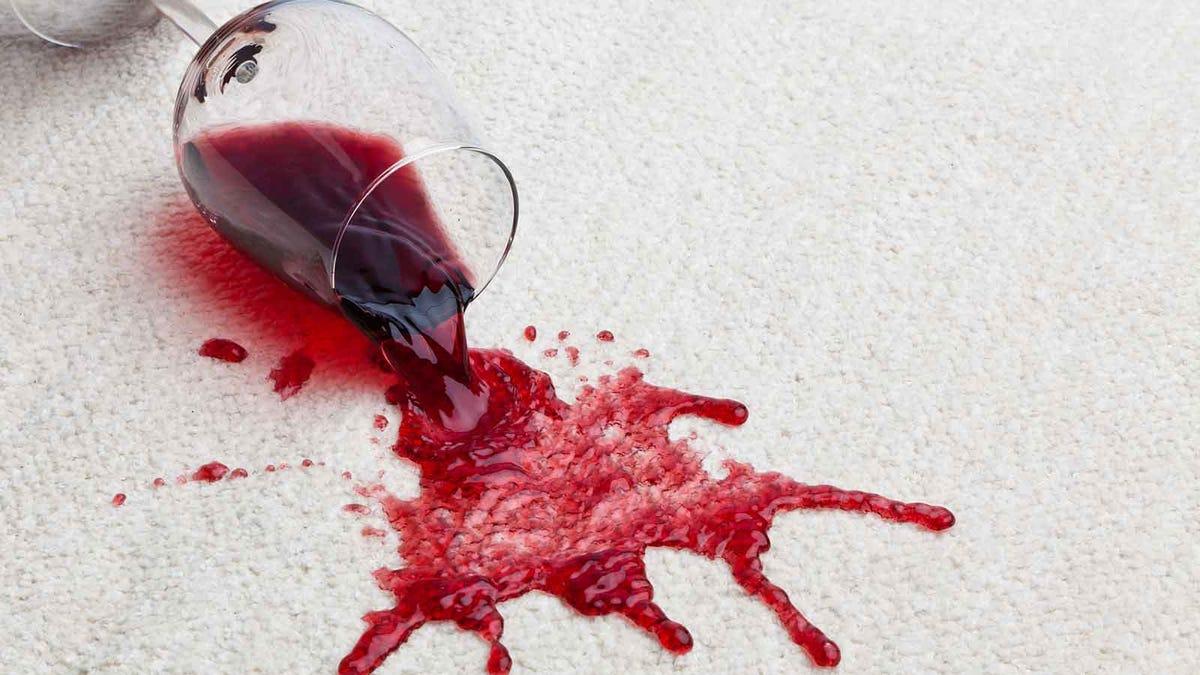 red wine spilling on a Berber carpet