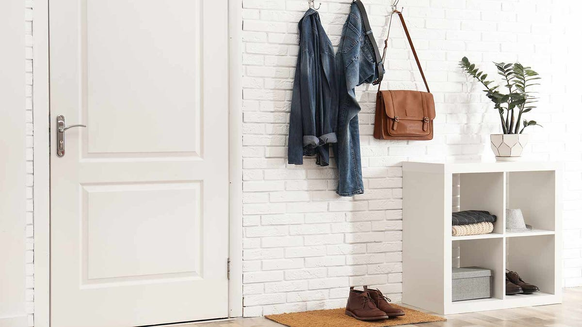 Tidy foyer with hanging hooks and storage cubbies for frequently used items