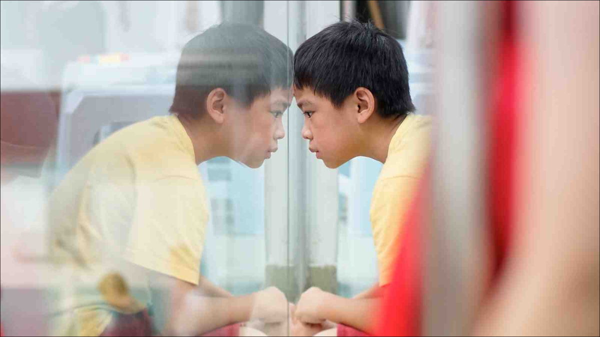 upset child leaning against window