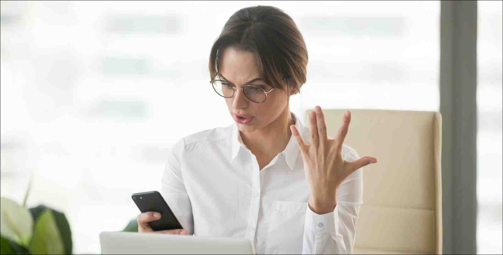 frustrated woman with no cell phone signal