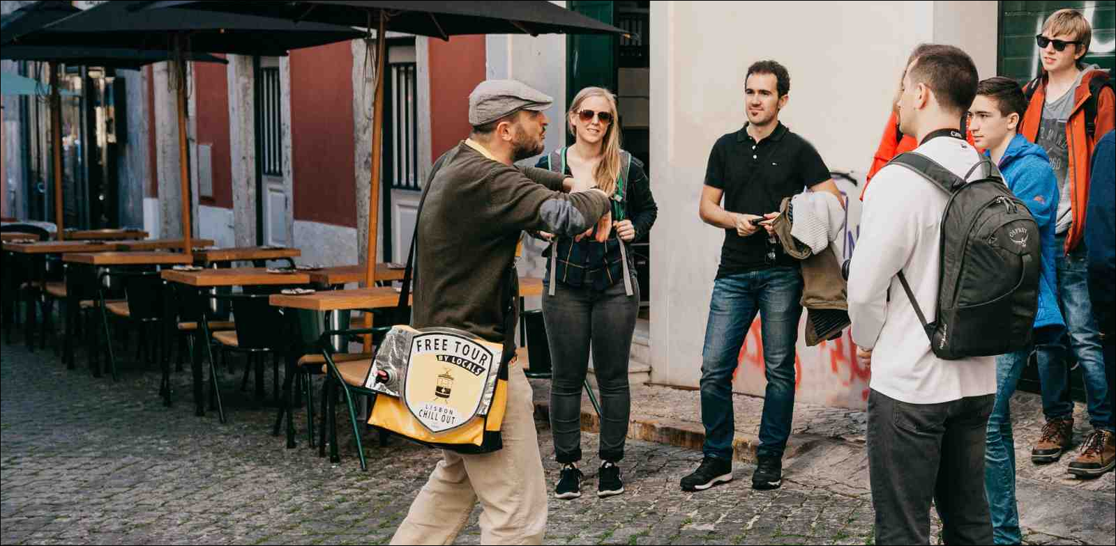 local guide in Lisbon gesturing to tourists