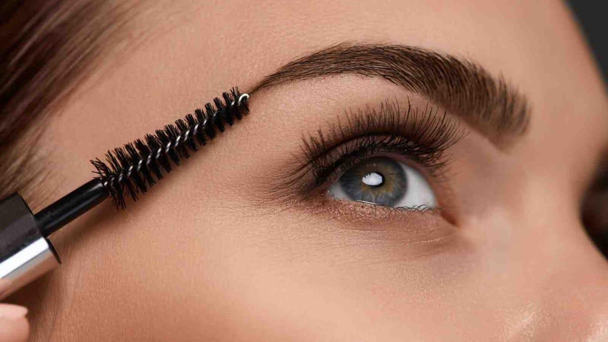 closeup of woman applying brow gel