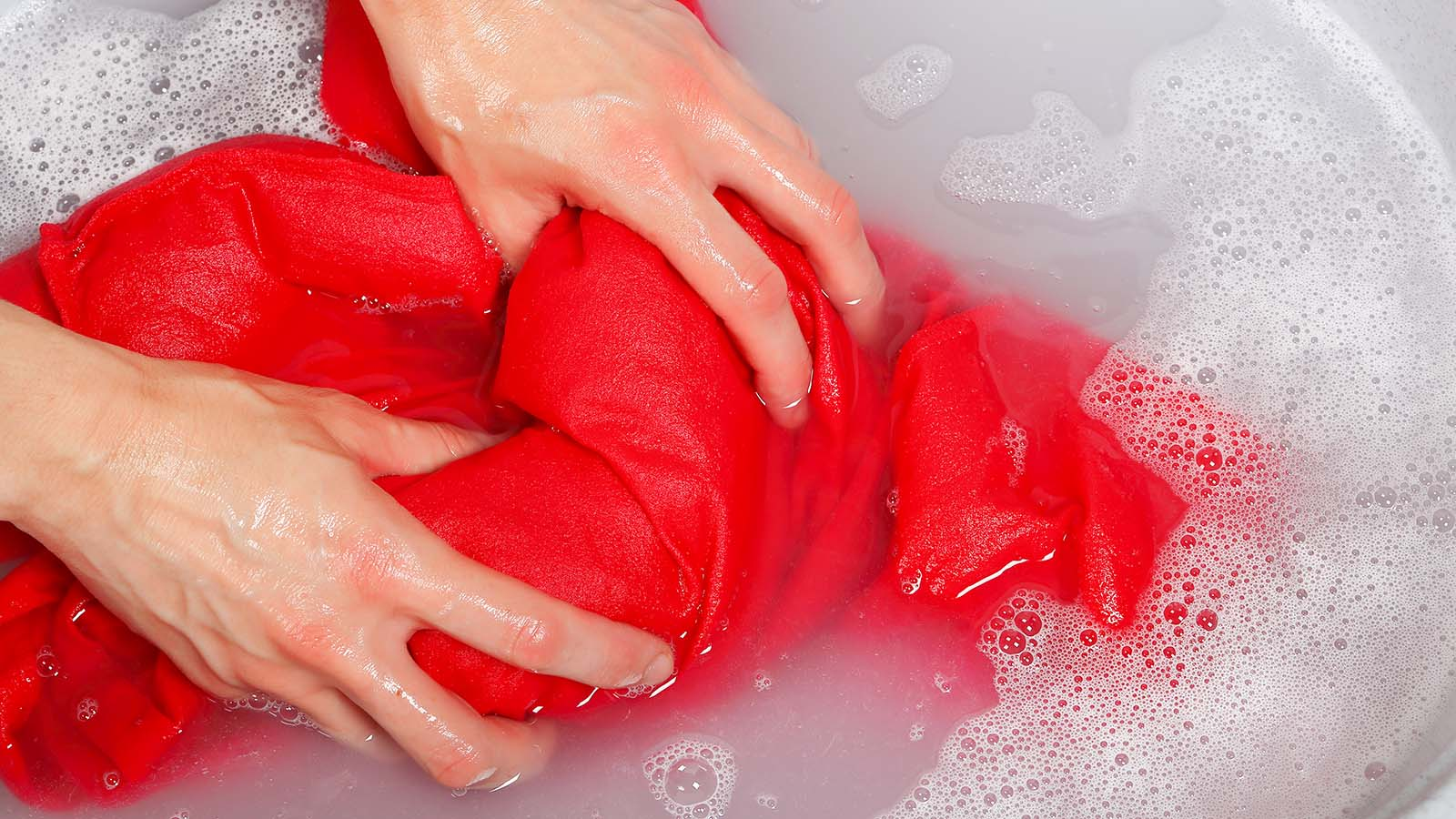 Person hand washing clothing