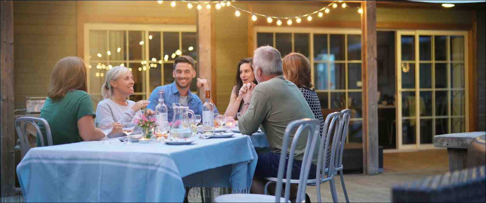 colleagues dining outdoors at casual restaurant