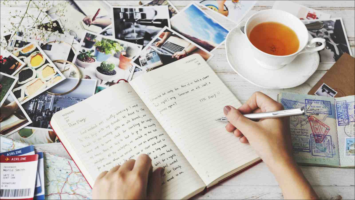 Hands Writing Travel Journal