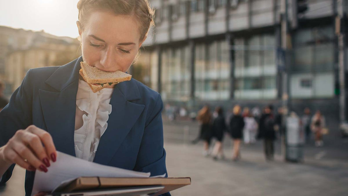 Busy woman rushing from one job to another