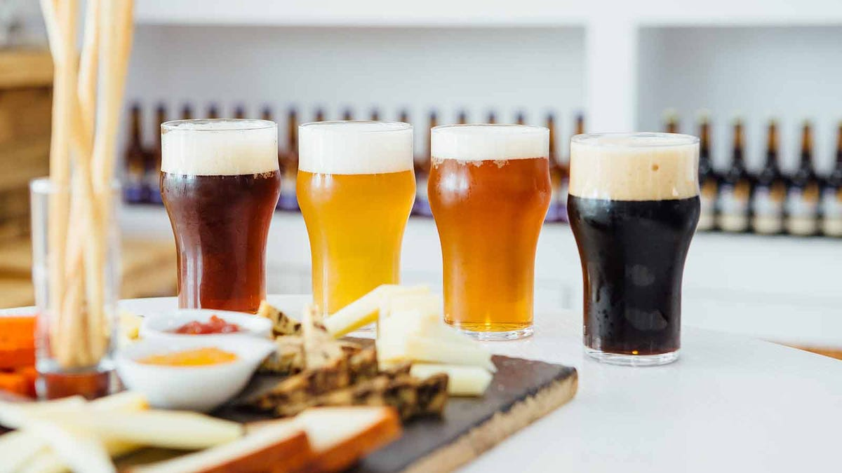 Different varieties of beers paired with a cheese platter