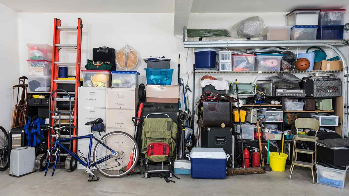 A cluttered garage, filled with items destined for recycling and disposal