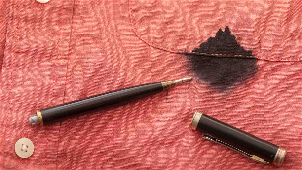 Close Up of a Broken Pen Resting on the Men's Red Shirt Stained with Ink
