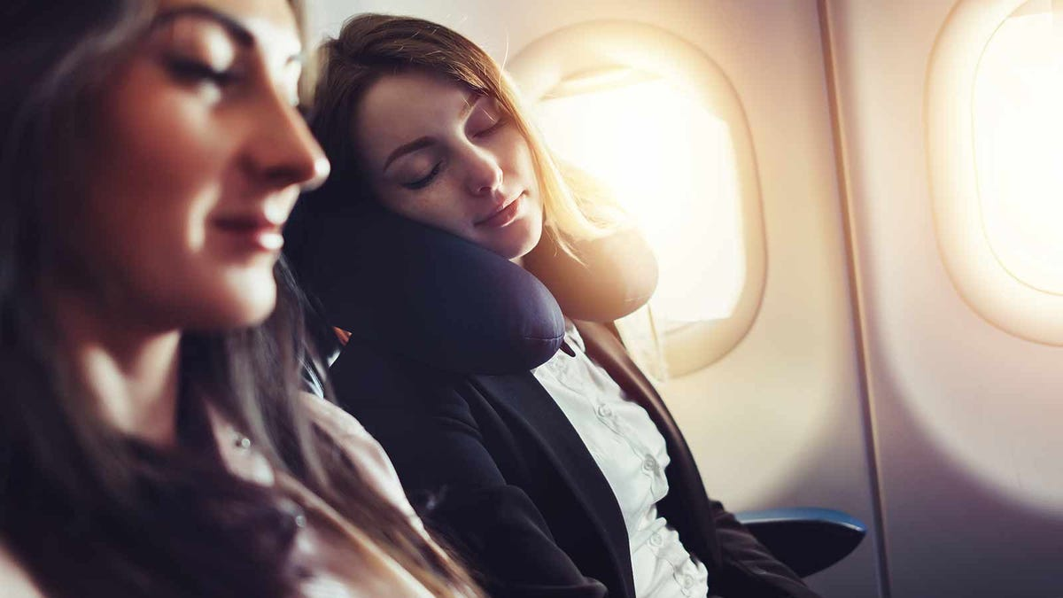 Woman sleeping peacefully on a plane