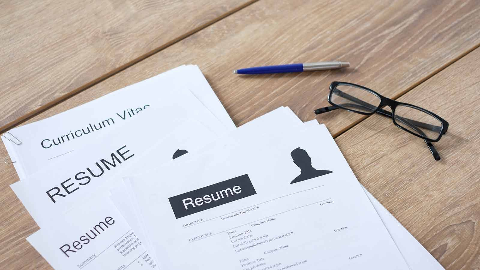 CVs and Curriculum Vitae on a Table