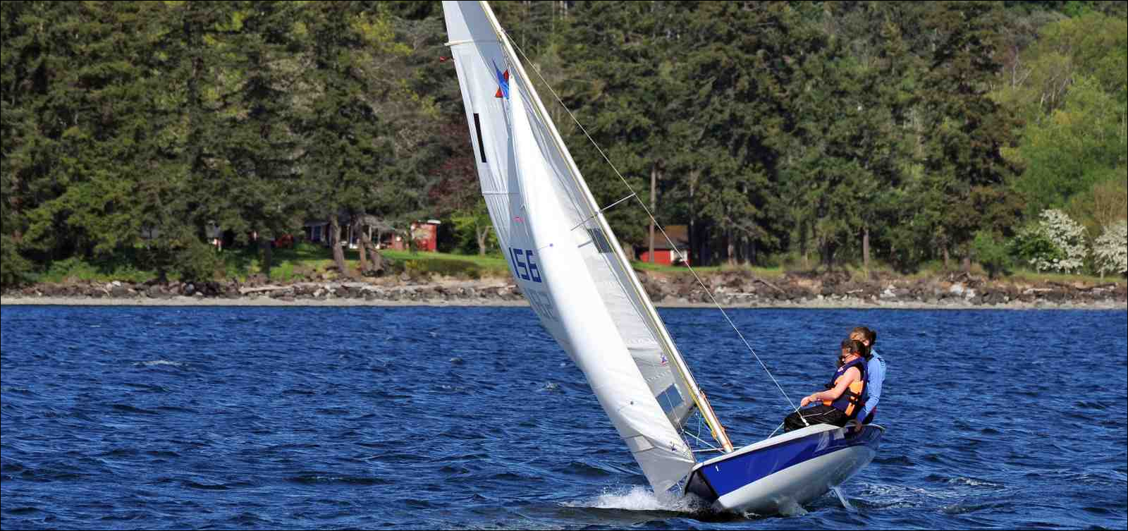 A couple learning to sail in Dye's Inlet, Silverdale, Washington