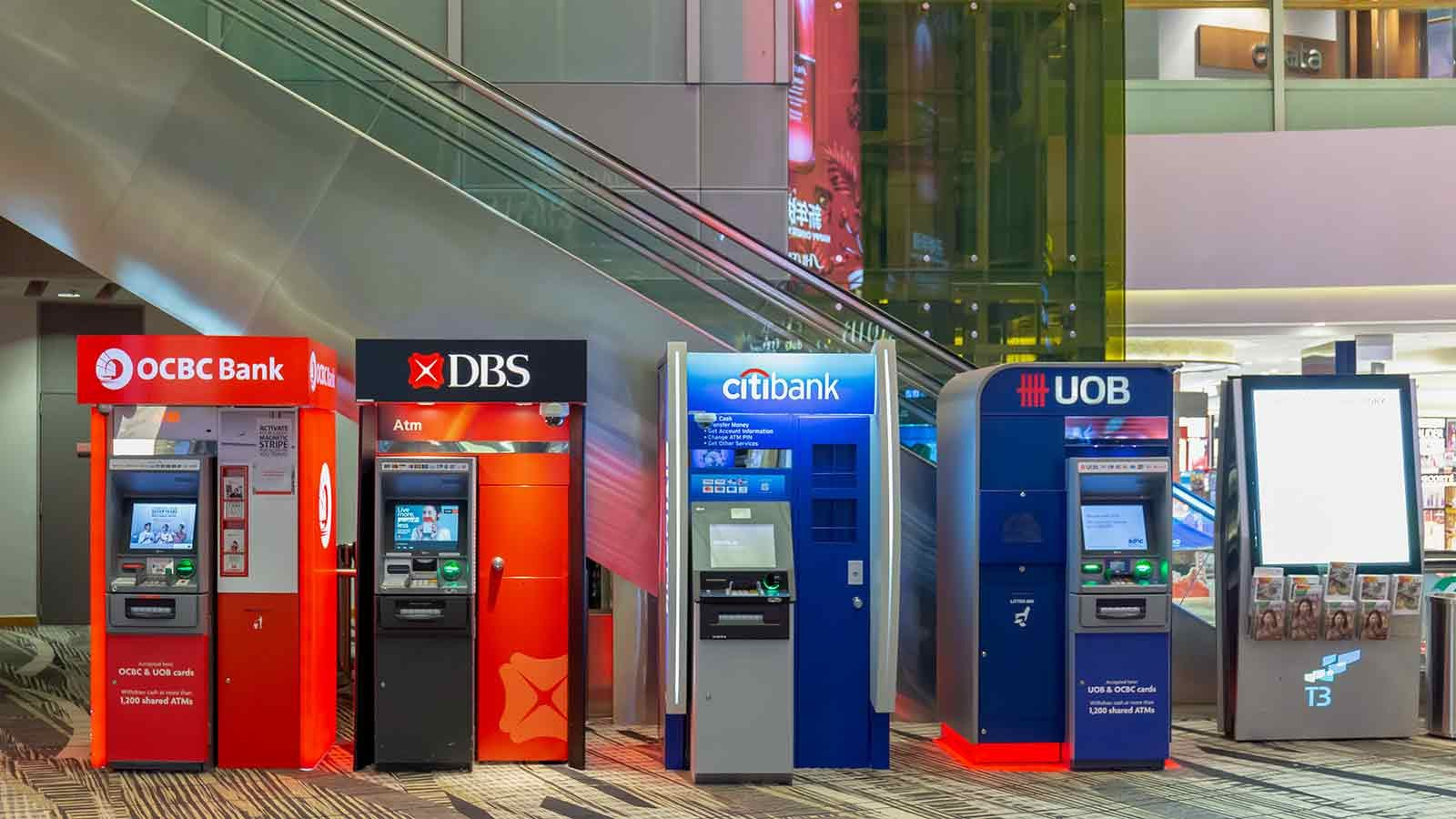A row of currency exchange ATMs in an airport.