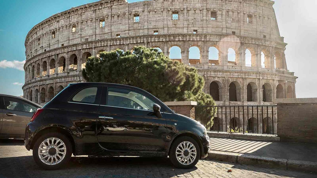 Car parked outside the Colosseum in Rome.
