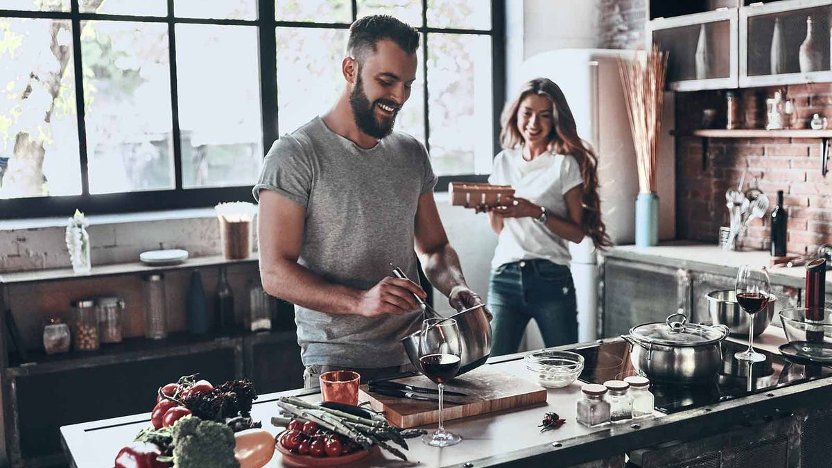 Couple cooking in a sunny kitchen