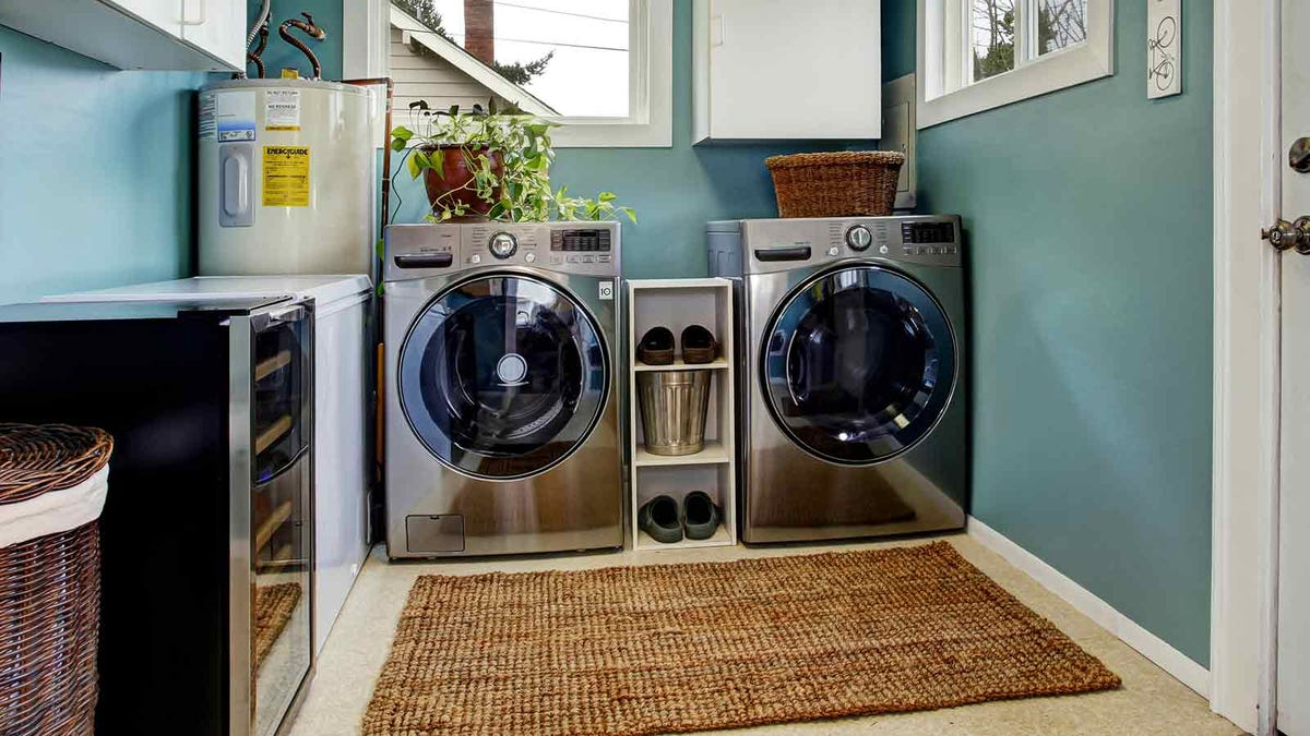 A washer and dryer pair in a sunny laundry room
