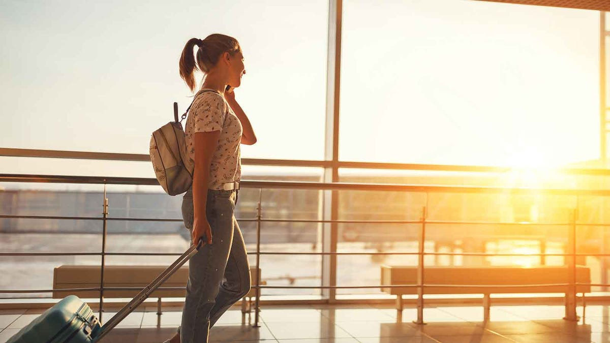 Young woman walking in an airport