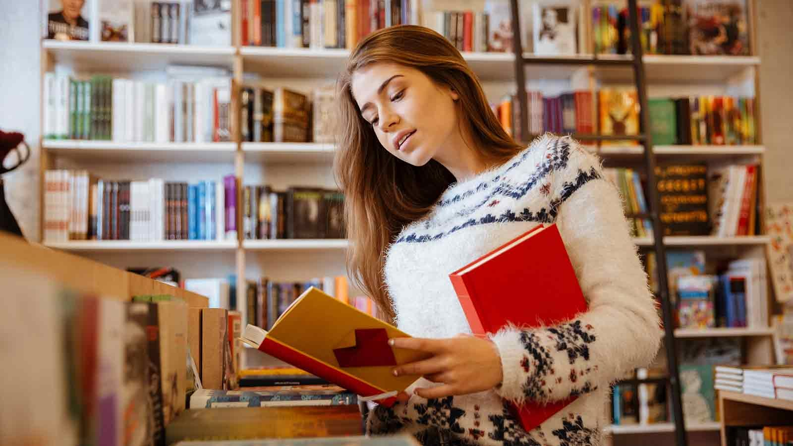 Woman browsing through the books at an independent bookstore