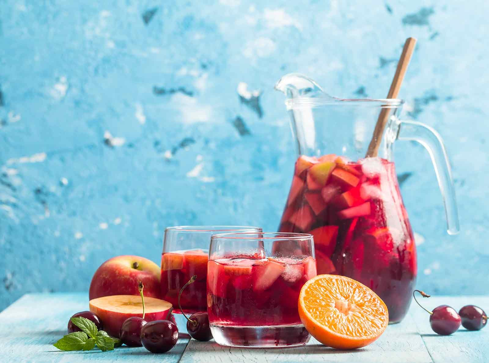 Pitcher of sangria with fruit on a table