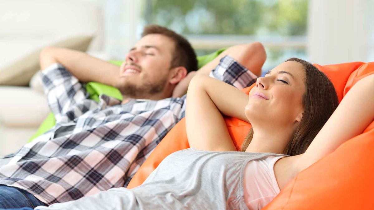 Couple relaxing in a cool and comfortable living room