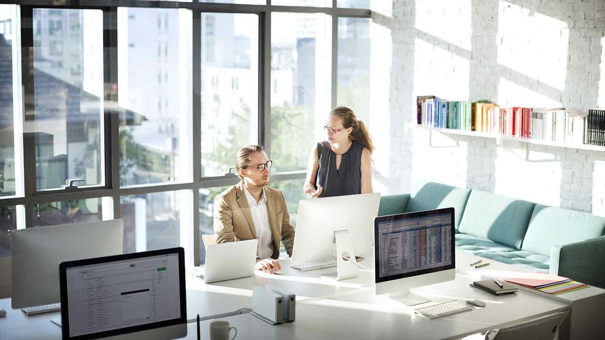 Talkative person distracts their coworker at the office