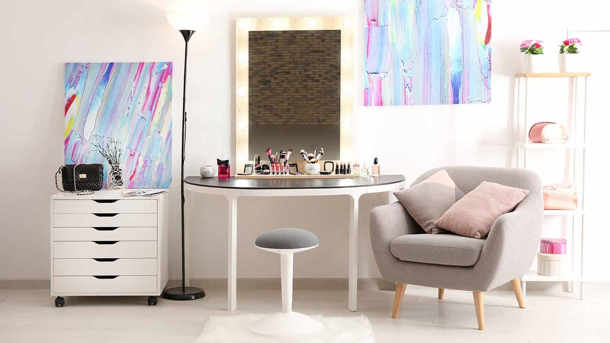 makeup displayed on a vanity table in a brightly lit room