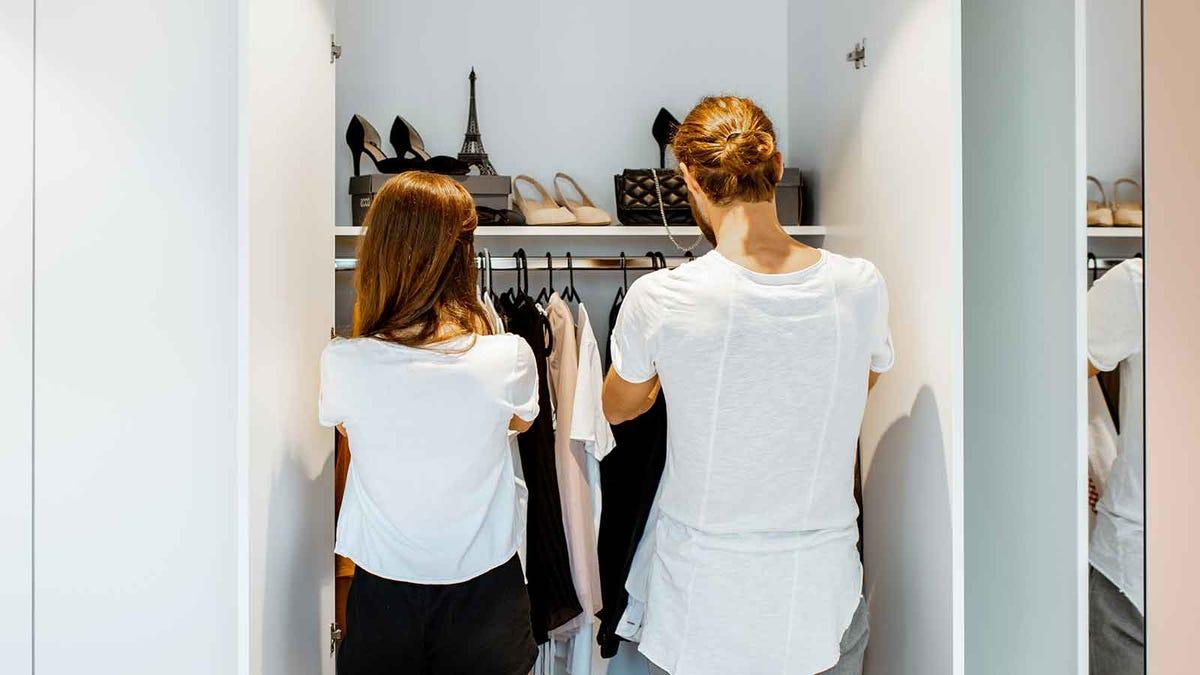 Couple sharing a small closet