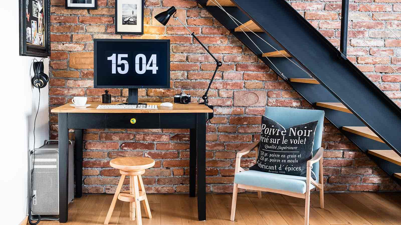 Compact home office tucked under a staircase