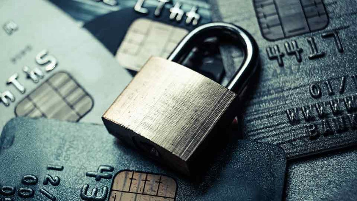 padlock resting on a pile of credit cards created using stolen identities