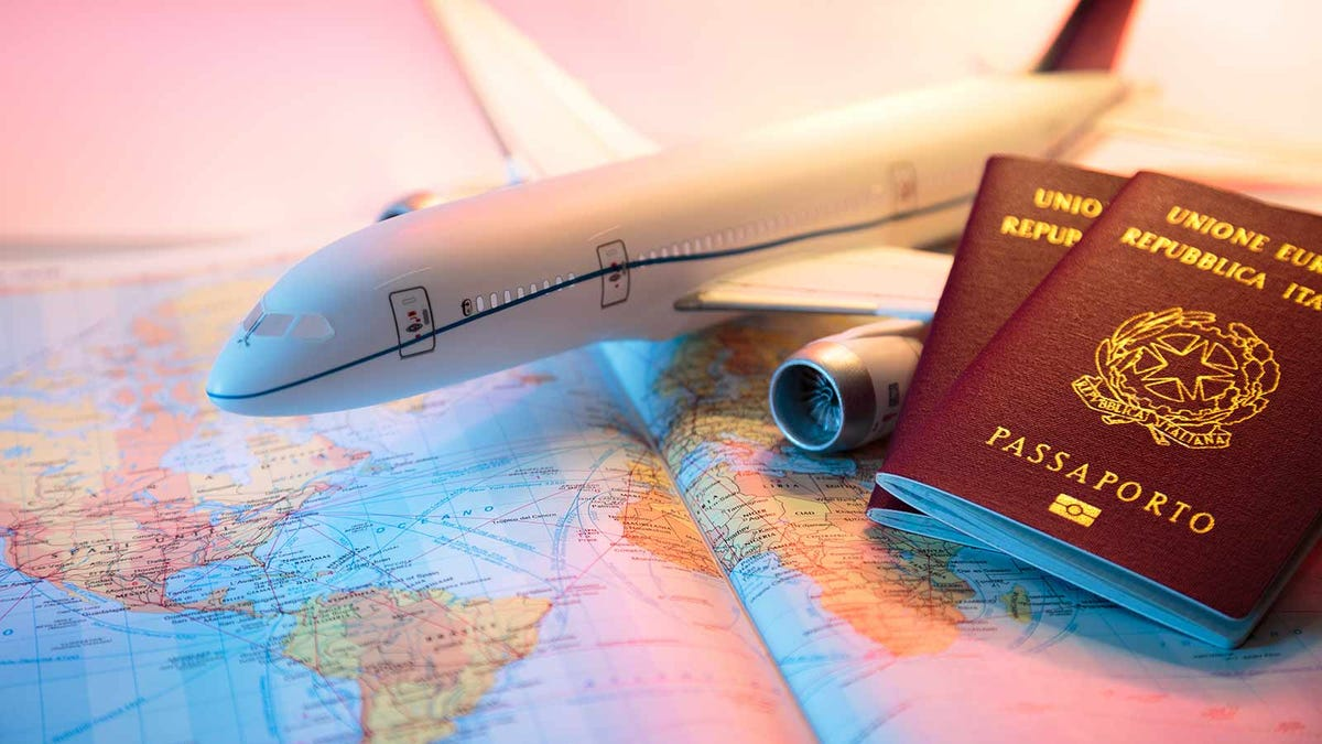 a model airplane and passports resting on a map