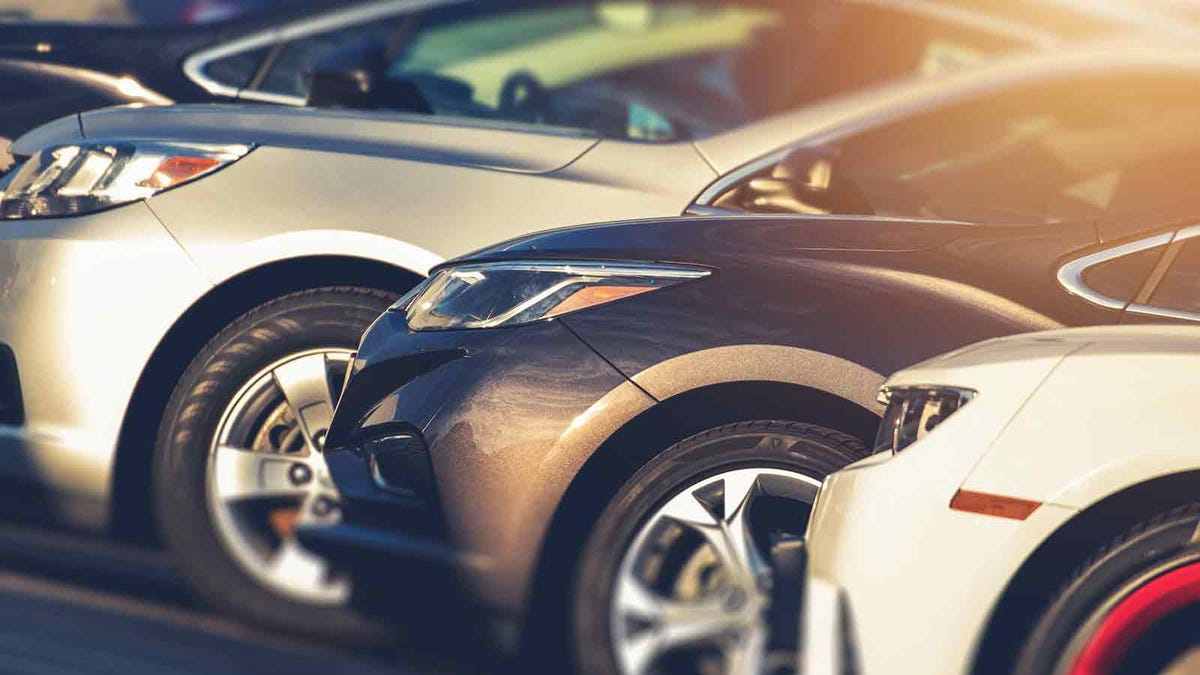 shiny cars lined up at the car dealer