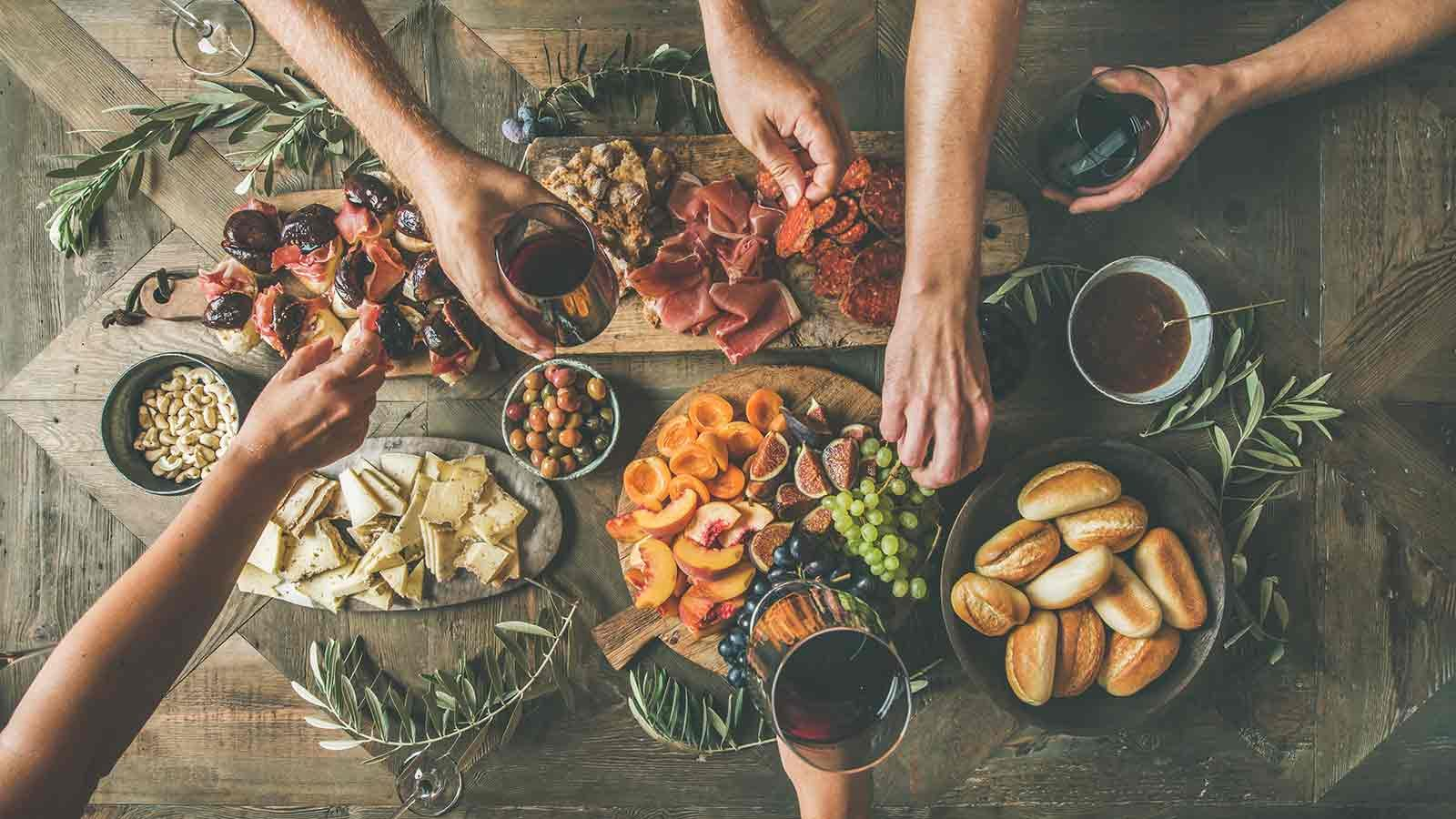 table laden with delicious snacks at a party