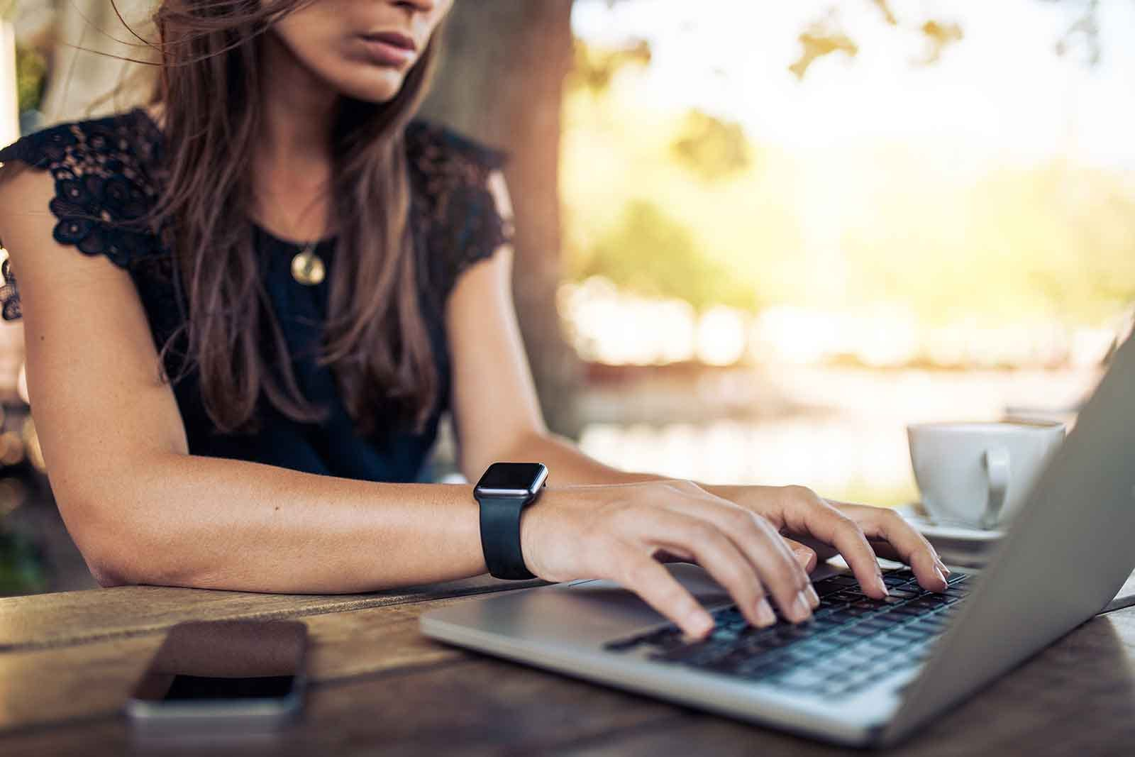 woman searching for remote work jobs using her laptop