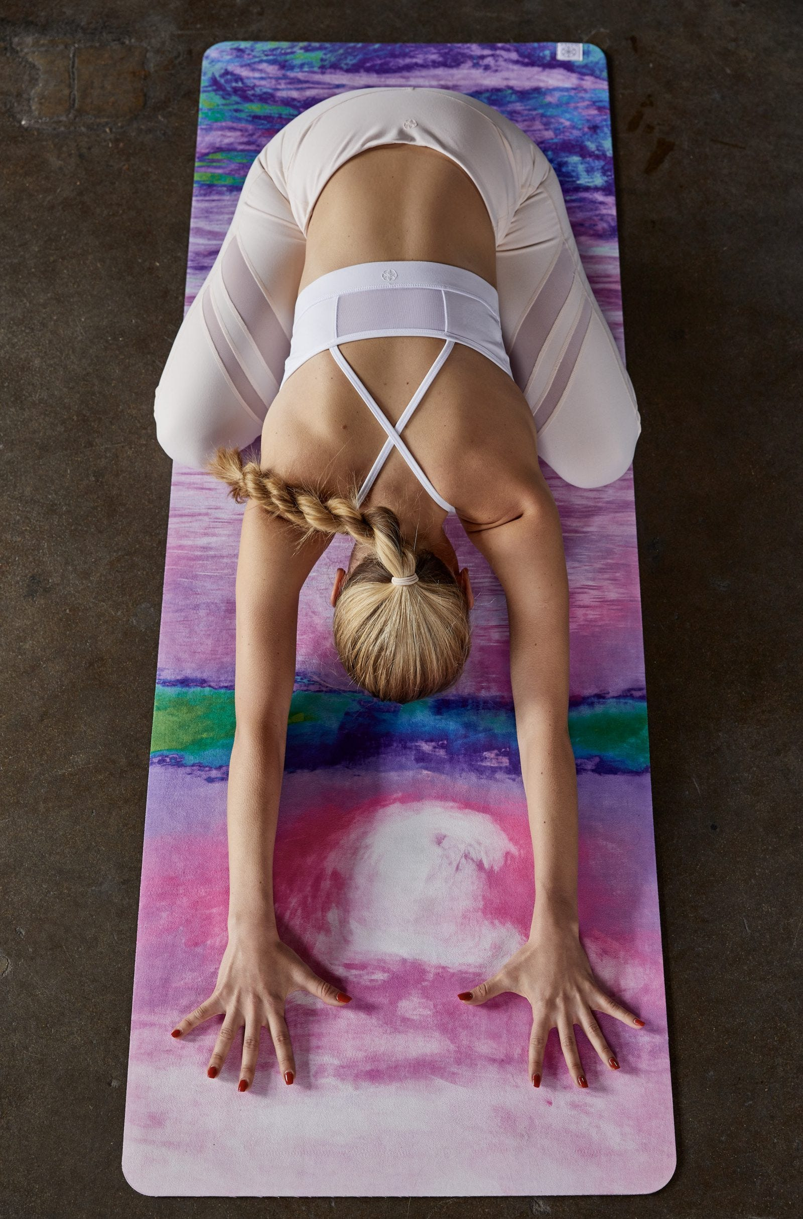 A woman in the Child's Pose Yoga position.