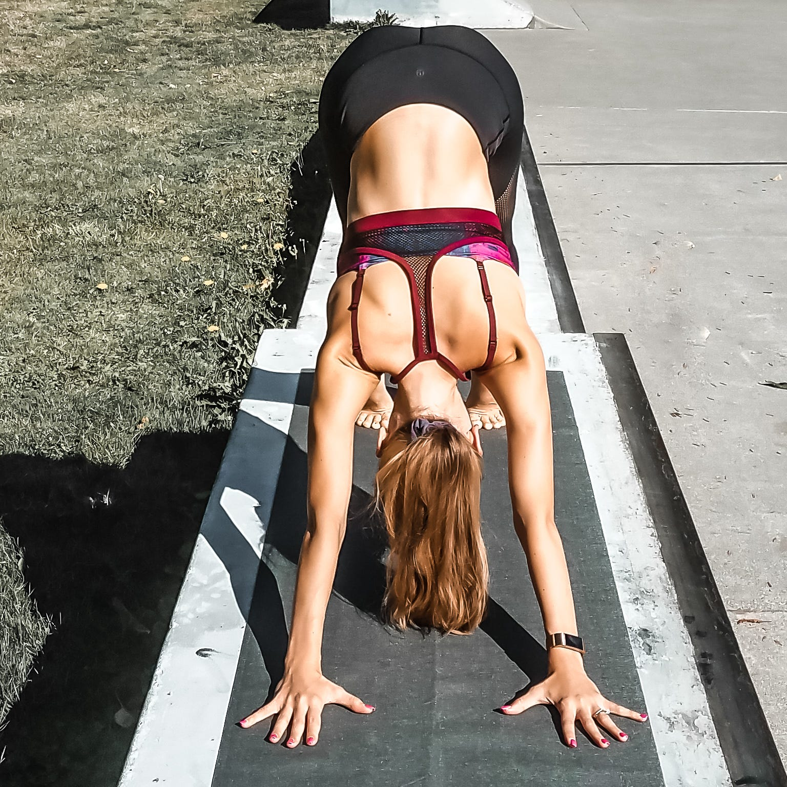A woman in the Downward-Facing Dog Yoga pose.