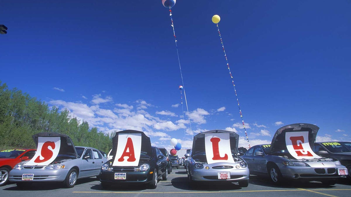 used cars lined up in a used car lot