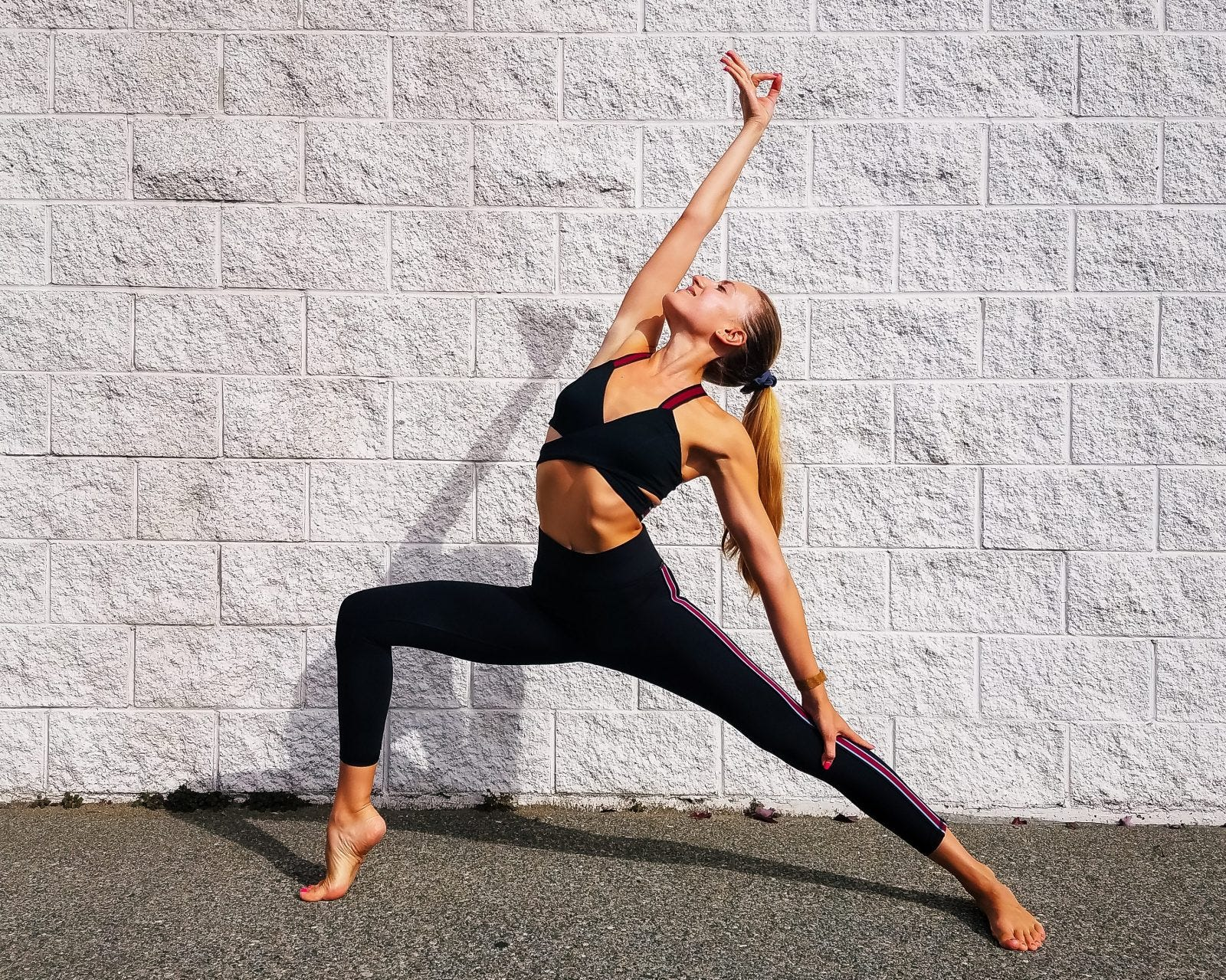 Woman Doing Yoga in front of a white wall