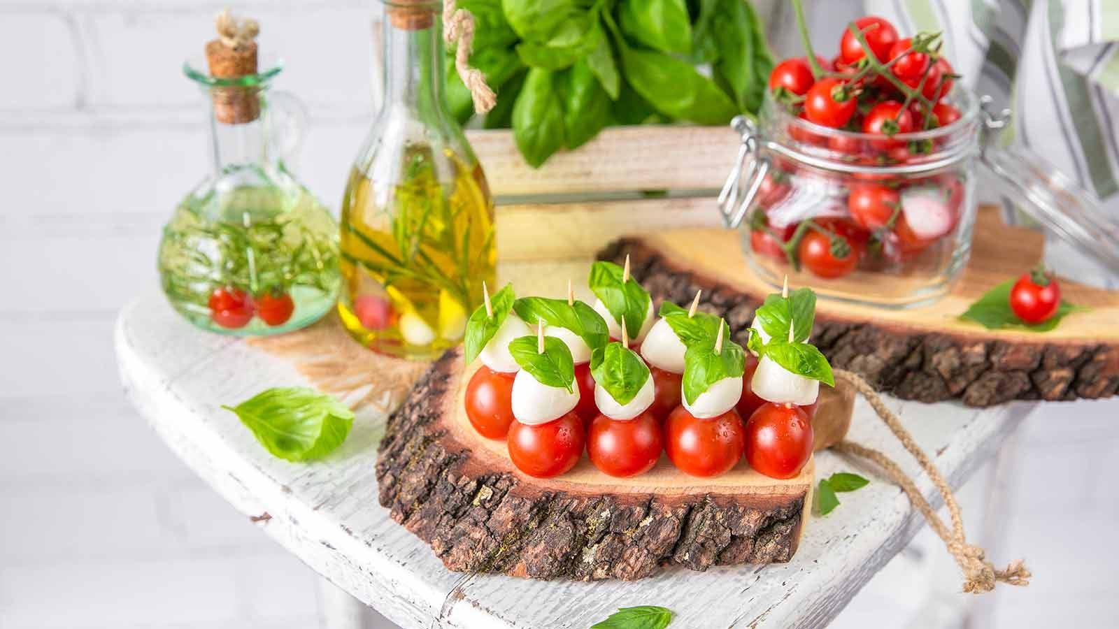 classic Italian caprese canapes made from tomatoes, mozzarella, and basil.